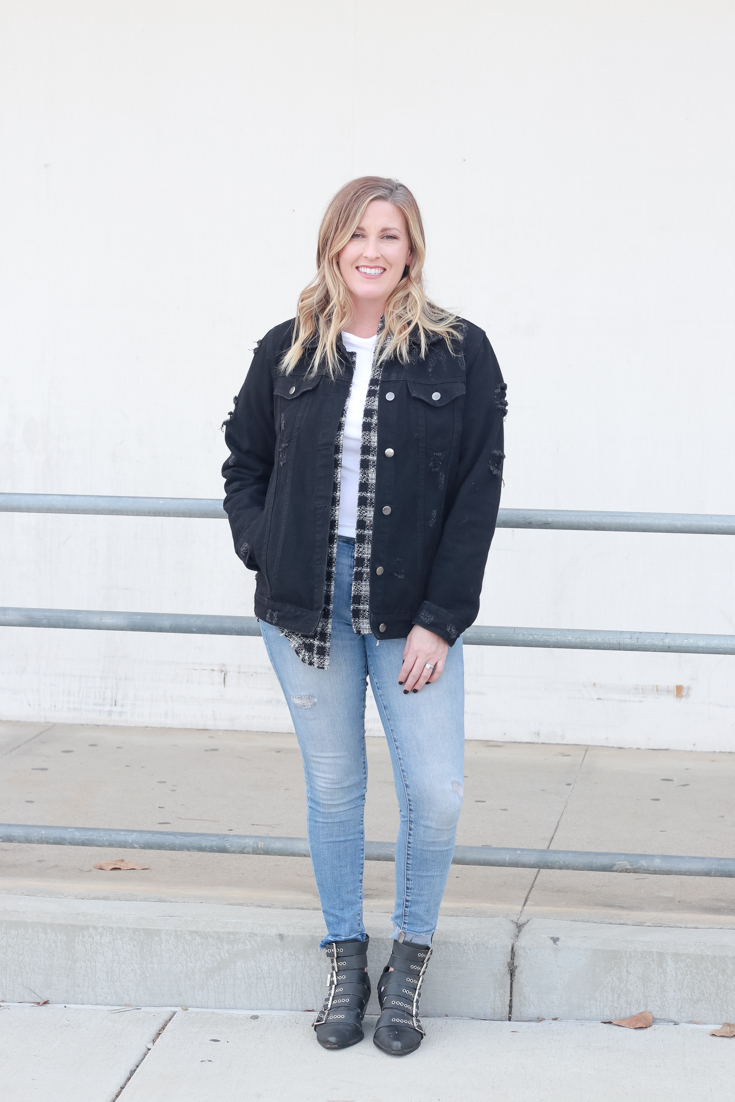 4 Ways To Wear A Shacket featured by popular US Style Blogger, Style & Wanderlust: photo of woman wearing jeans and a plaid shacket with a black denim jacket.