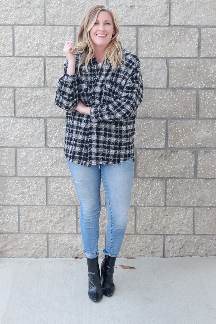 4 Ways To Wear A Shacket featured by popular US Style Blogger, Style & Wanderlust: photo of woman wearing jeans and a plaid shacket.