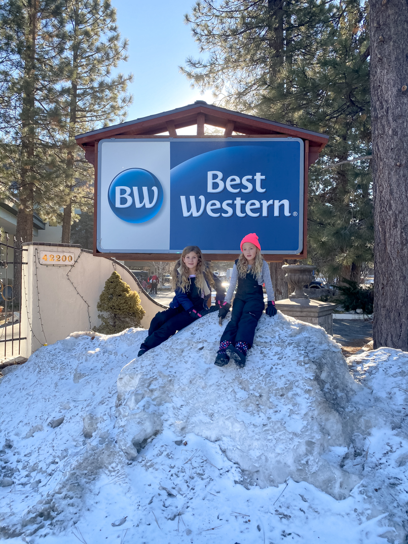 24 Hours In Big Bear featured by Top US Travel Blog, Style & Wanderlust; kids sitting in front of Best Western