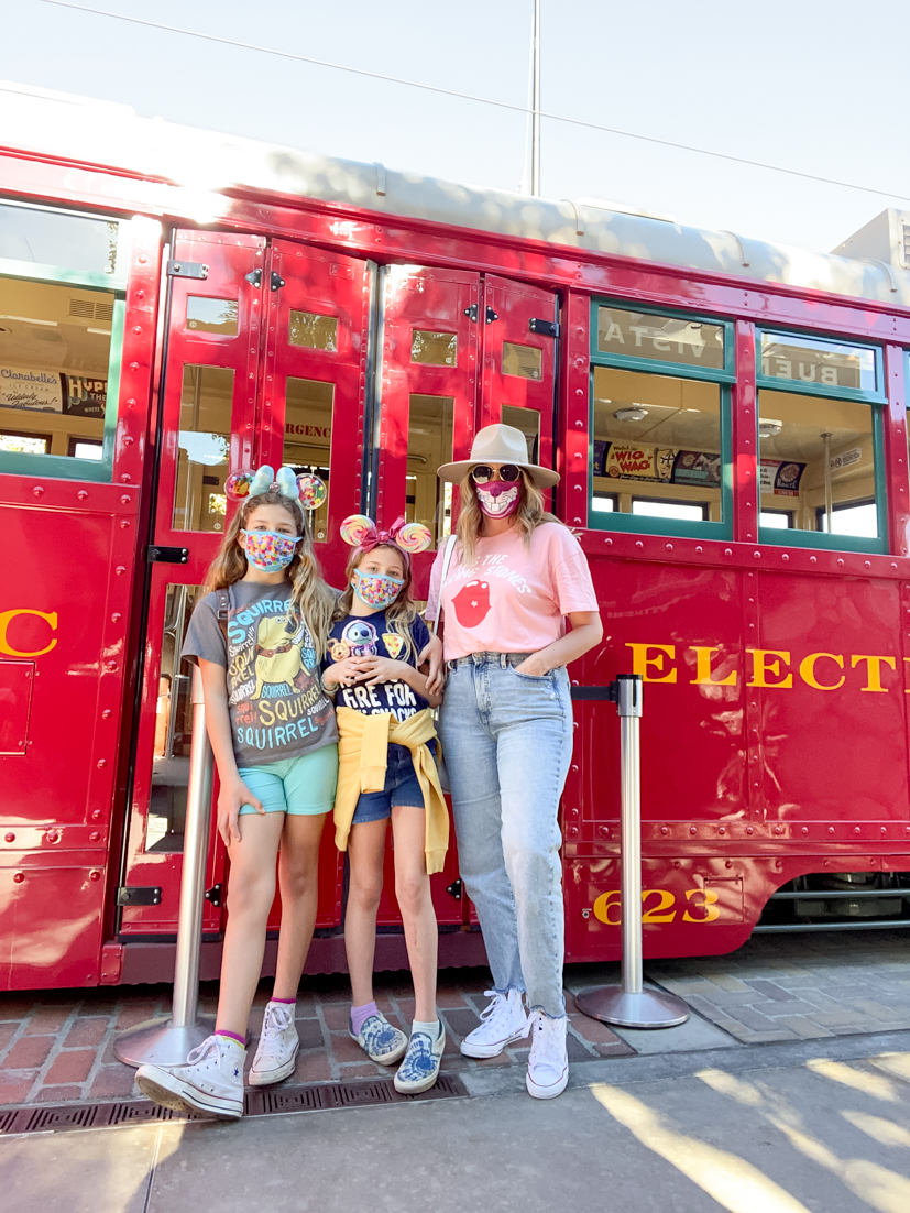 Local Love: 5 Best Things To Do In Orange County with kids this spring featured by popular US Travel Blogger, Style & Wanderlust; Mom and two girls at downtown Disney