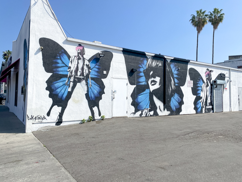 Top US Travel Blogger, Style And Wanderlust shares Must See Murals on Melrose in West Hollywood; woman butterfly mural.